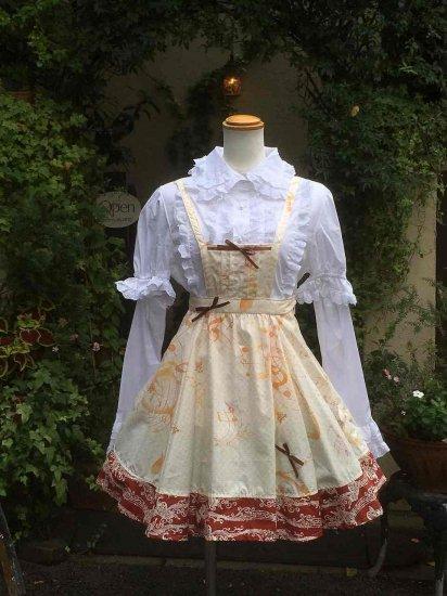 フリルワンピース 音符とリボンのクラシカルエプロン風ジャンパースカート