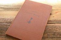 表紙にカギの絵がある赤いフランスのアンティークブック・本(フランスの洋書、古書)